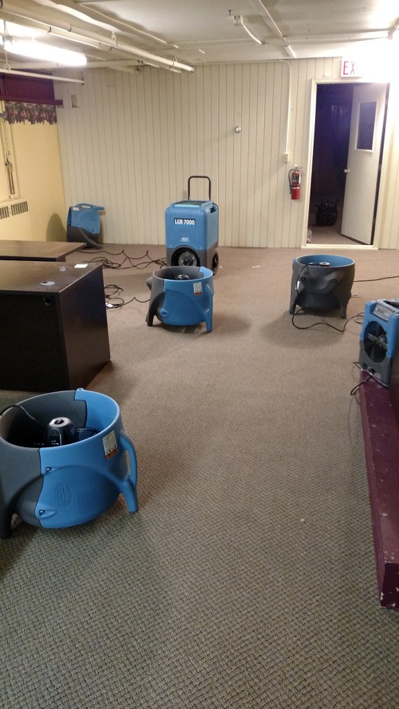 Commercial dehumidifiers and air movers used to dry this office that was flooded with 800 gallons of water in a water mitigation project completed by Tri-County Restoration & Cleaning.